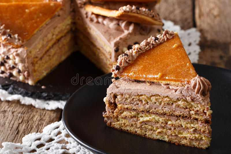 Delicious slice of Hungarian Dobosh cake with caramel close-up. royalty free stock image
