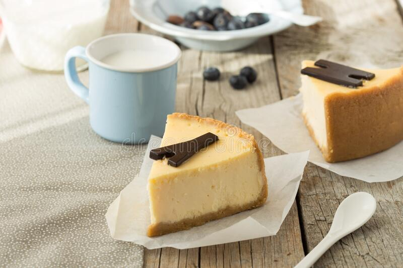 Delicious slice of new york cheesecake on grey background, isolated. Sweet and tasty food, coffee break concep. Classic american d. Essert royalty free stock photography