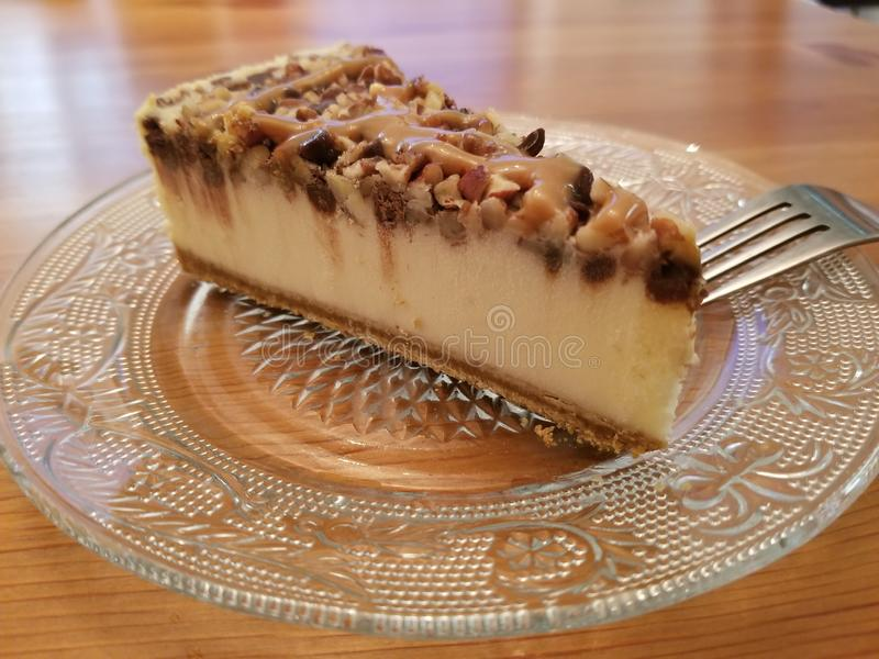 Delicious Slice of Pecan Cheese Cake stock photography