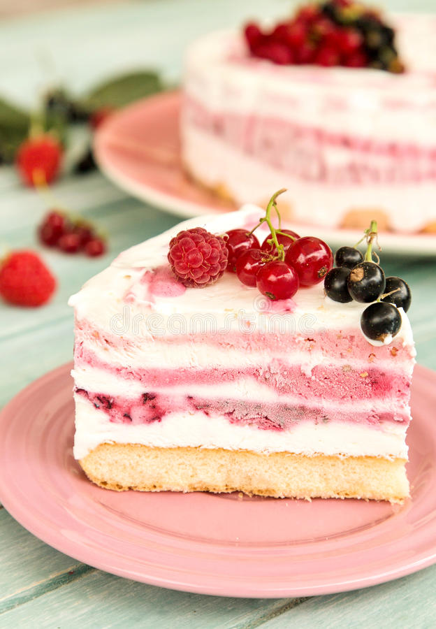 Delicious slice of three fruit layers ice cream cake stock photo