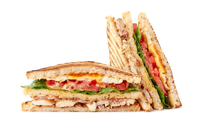 Delicious sliced club sandwich on white background. Delicious sliced club sandwich isolated on white background royalty free stock photography