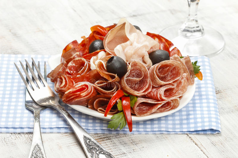 Delicious sliced ham. Platter of assorted cured meats and stock image