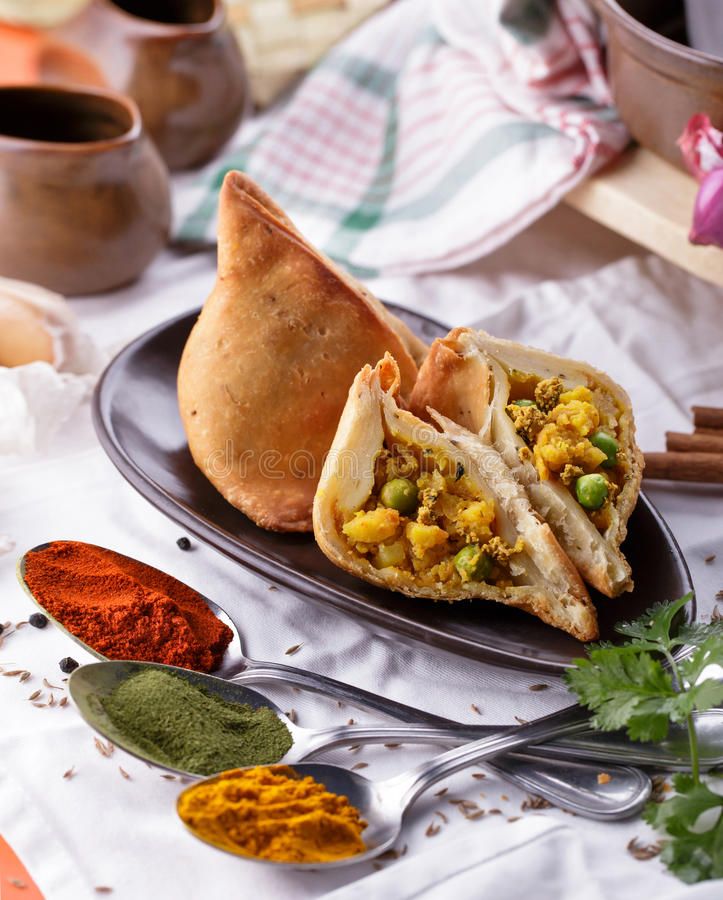 Delicious sliced indian samosa royalty free stock photography