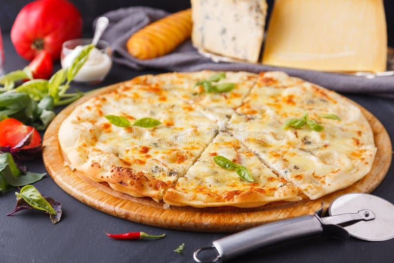 Pizza four cheeses royalty free stock photos