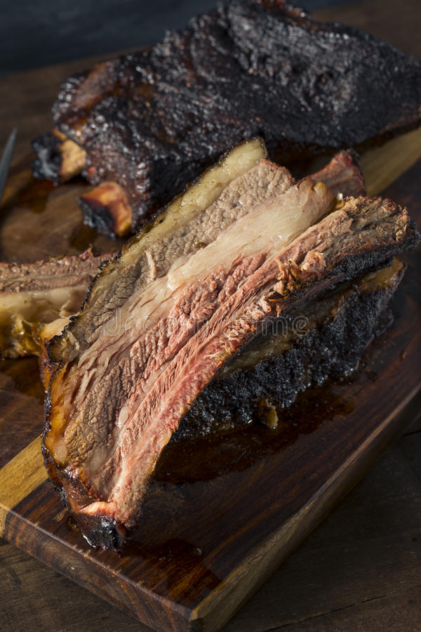 Delicious Smoked Beef Ribs. With Barbecue Sauce stock photo