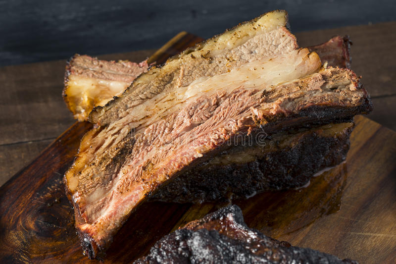 Delicious Smoked Beef Ribs. With Barbecue Sauce royalty free stock photography