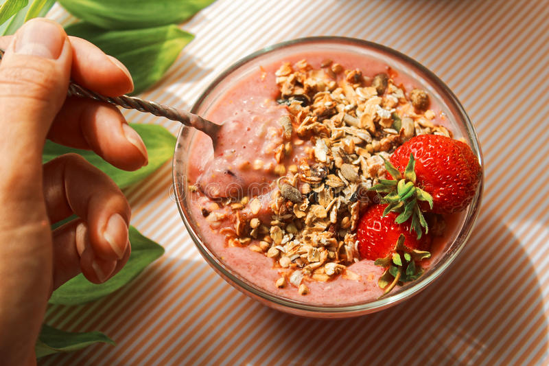 Delicious smoothie with granola and strawberries. Healthy, tasty and nutriotious. Every day meal. Before or after workout stock images