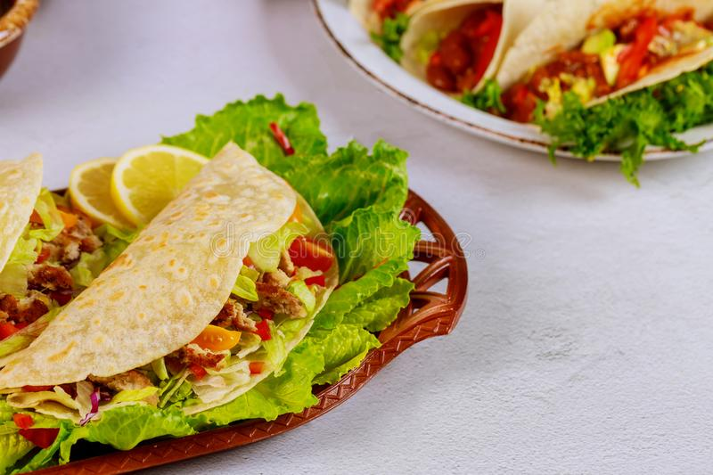 Delicious soft tortillas with salad and meat. Mexican cuisine stock image