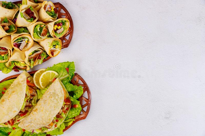 Delicious soft tortillas with salad and meat. Mexican cuisine stock images