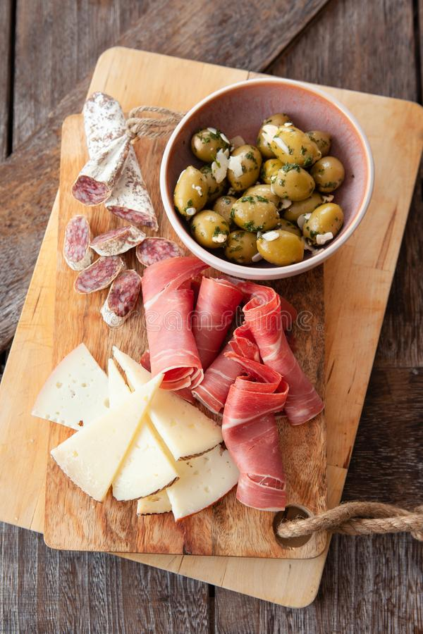 Delicious Spanish tapas. With cured meat, cheese and olives royalty free stock image