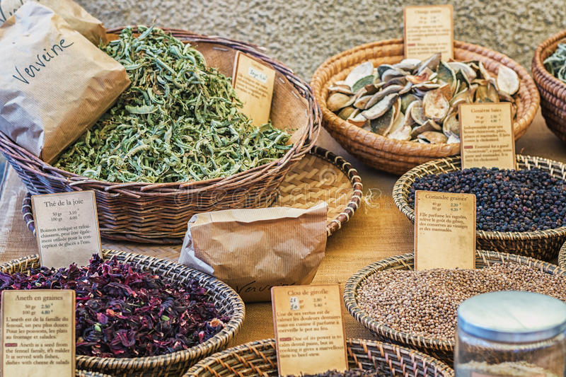 Delicious spices for sale on the market in Vallon Pont d`Arc. Vallon Pont d'Arc, France – September 22, 2016: delicious spices for sale on the stock image