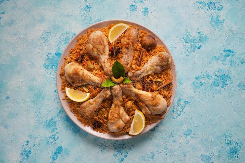 Delicious spicy chicken Biryani on blue table. stock photos