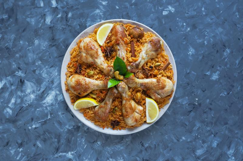 Delicious spicy chicken Biryani in white bowl on black background, Indian or Pakistani food. royalty free stock photography