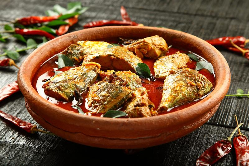 Delicious spicy fish curry. Homemade Delicious spicy fish curry cooked in clay pot stock photo