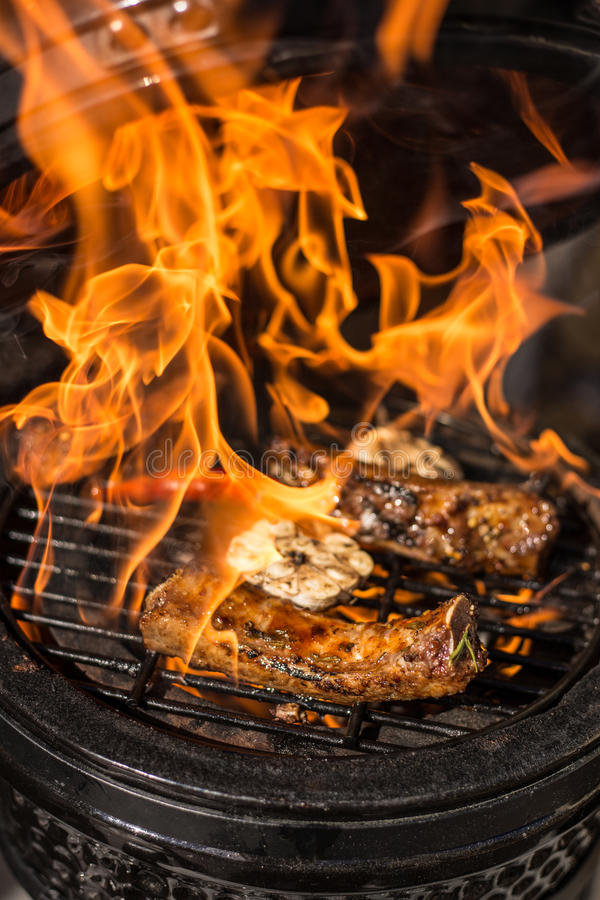 Delicious spicy marinated spare ribs on hot flaming grill. Barbecue. Restaurant stock photos