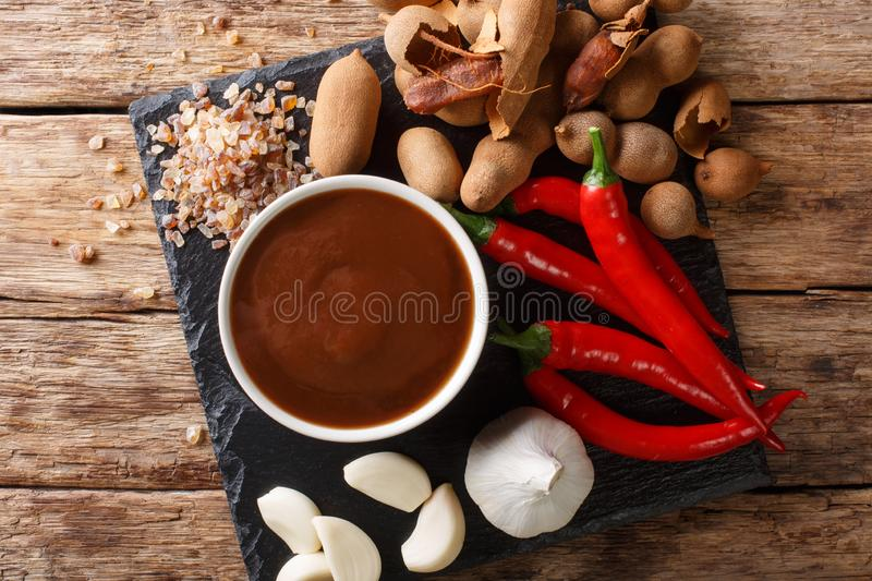 Delicious spicy tamarind sauce closeup in a bowl on a table. horizontal top view royalty free stock photo