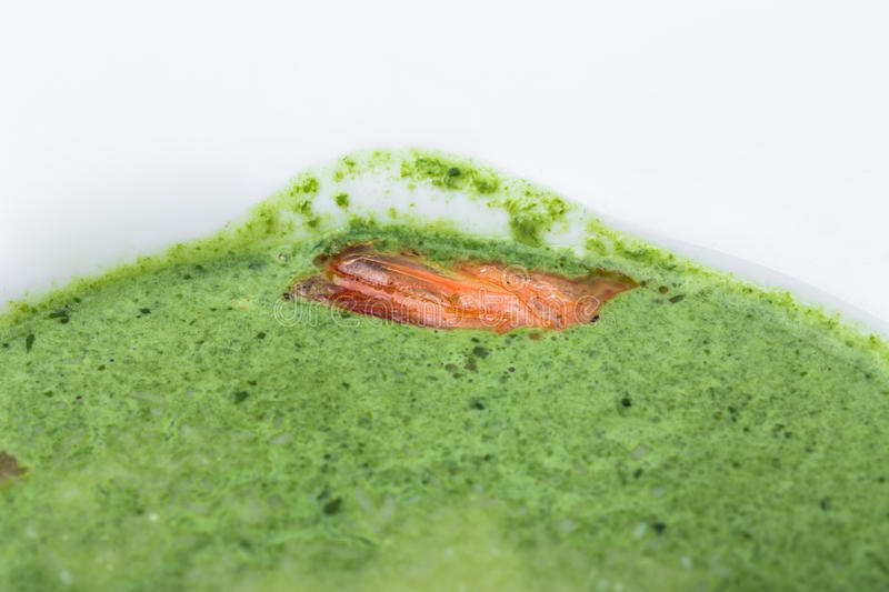 Delicious spinach cream soup with prawns. stock photography