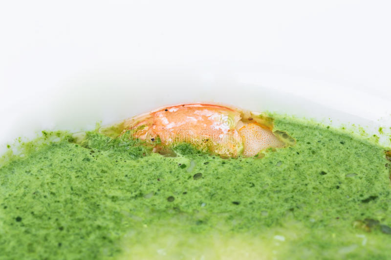 Delicious spinach cream soup with prawns. stock photos