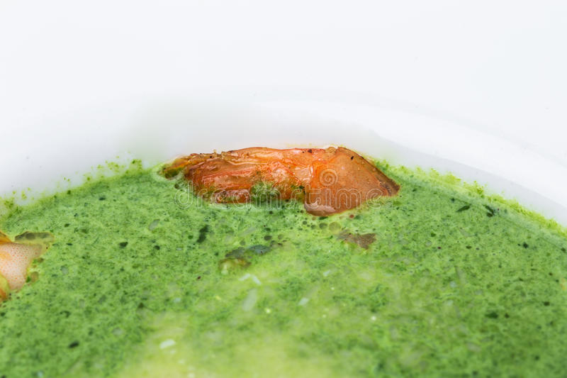 Delicious spinach cream soup with prawns. stock image