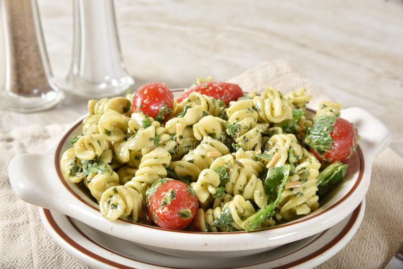 Delicious spinach pasta salad royalty free stock photography