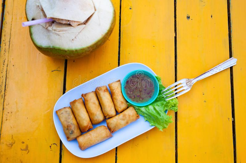 delicious spring rolls on a yellow table - happy meal stock images