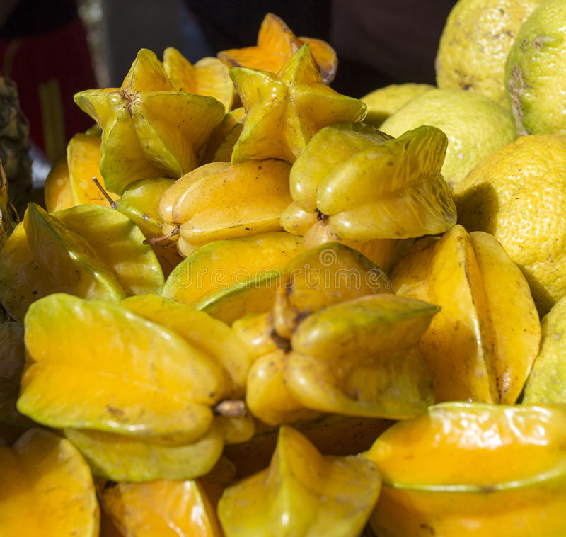 Delicious star fruit. Lay in cluster on table stock image