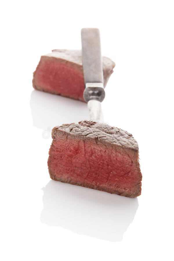 Delicious steak on fork. royalty free stock image