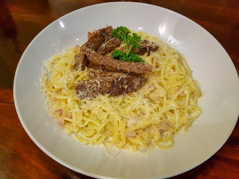 Delicious steak pasta stock images