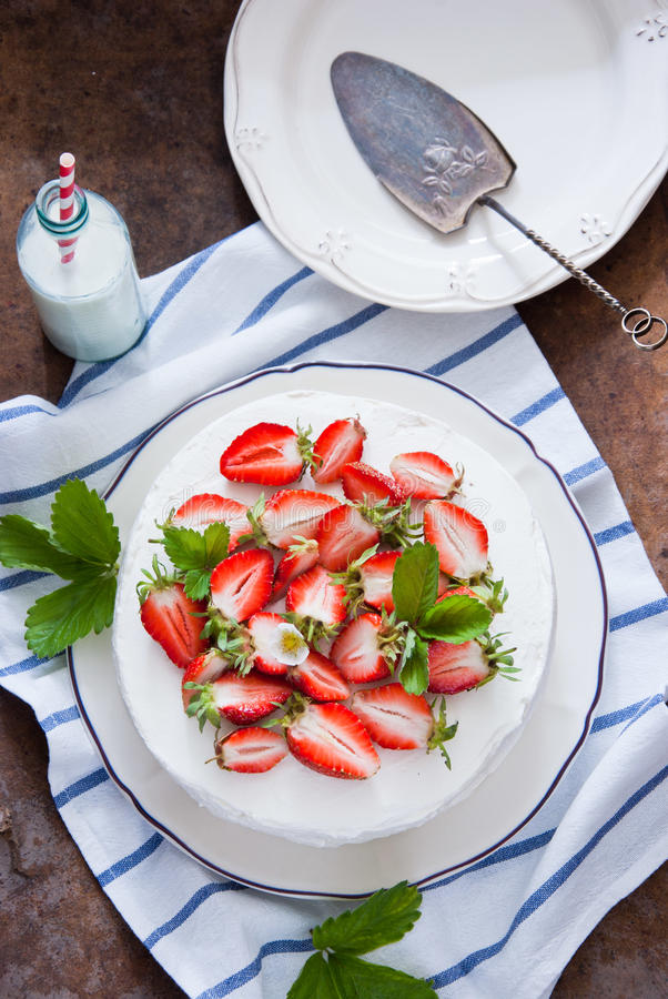 Delicious Strawberry cake. With whipped cream and fresh strawberries royalty free stock photos