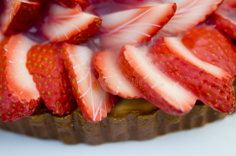 Delicious strawberry dessert. Close up of delicious looking strawberry desert cake royalty free stock photography