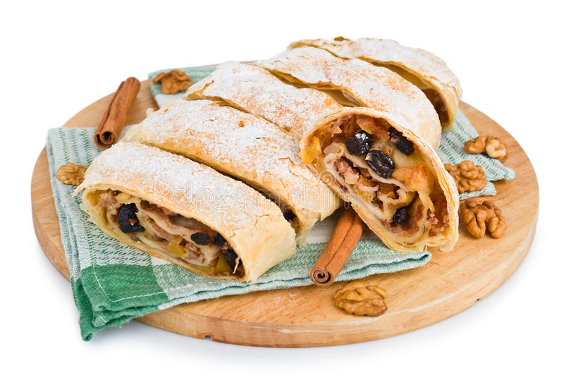 Delicious strudel. Studio close up of delicious apfelstrudel (apple pie) on white background stock photography
