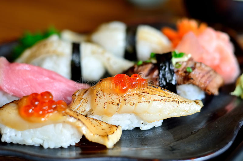 Delicious Sushi and japanese food. And sashimi royalty free stock photography