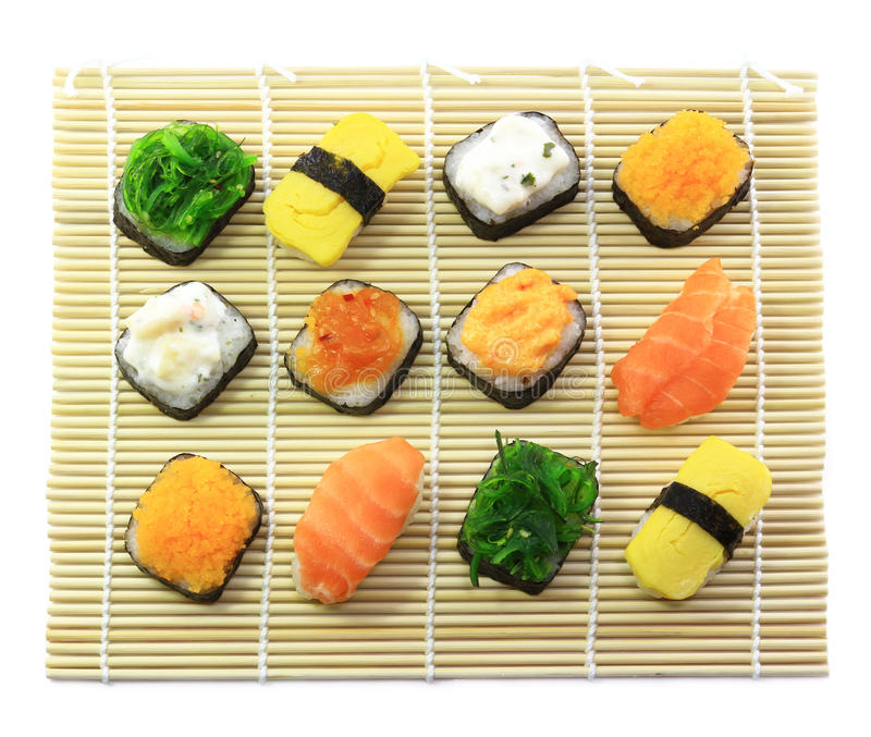 Delicious sushi rolls. On sushi mat stock photo