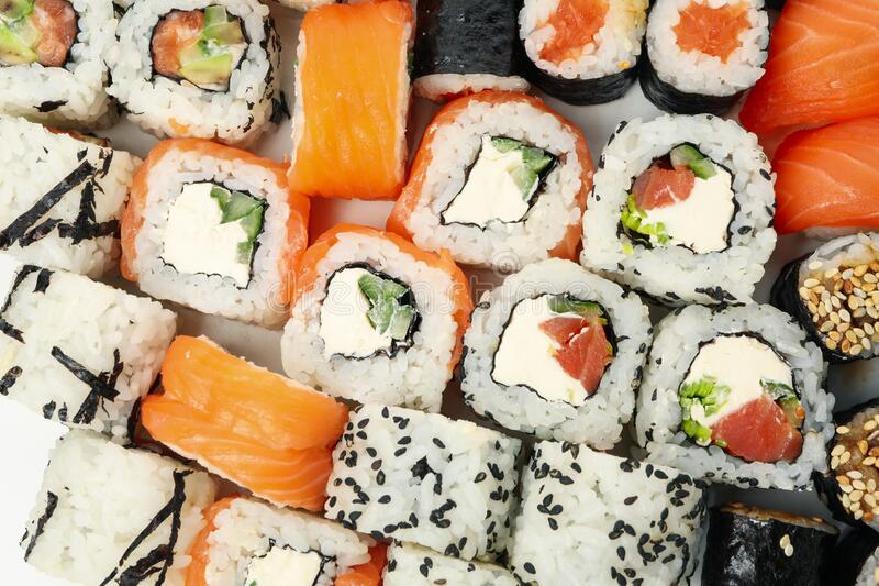 Delicious sushi rolls background. Japanese food. Delicious sushi rolls background, top view. Japanese food stock image