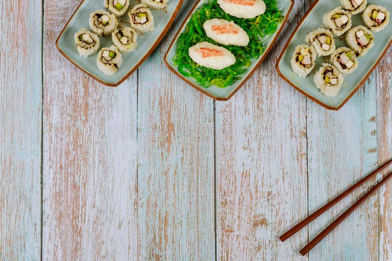 Delicious sushi and rolls with chopstick for party stock images