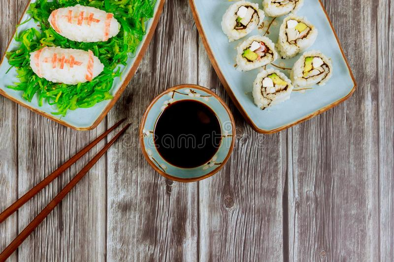 Delicious sushi and rolls with soy sauce and chopstick for american football game party. For fan royalty free stock photography