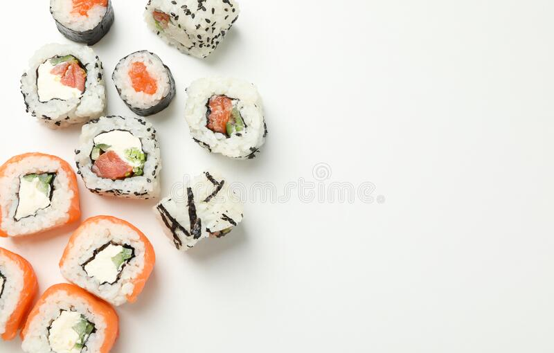 Delicious sushi rolls on white background. Japanese food. Delicious sushi rolls on white background, top view. Japanese food stock photo