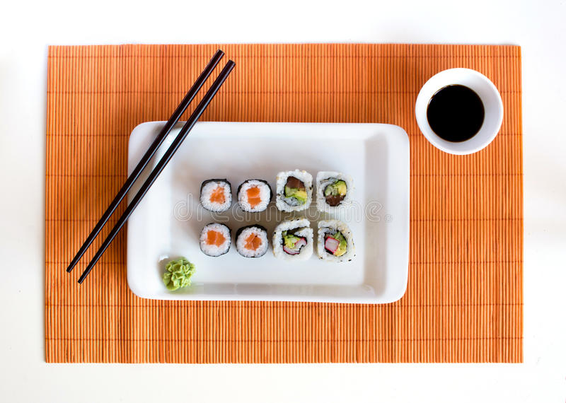 Download Delicious Sushi Rolls On White Plate With Chopsticks Royalty Free Stock Photo - Image: 34125595