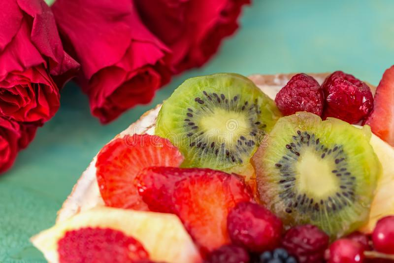 Delicious sweet cake with berries. Strawberries, kiwi, currants, blackberries, raspberry, pineapple on the biscuit. Fruit variety. stock images