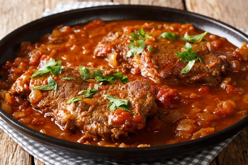 Delicious Swiss steak fried and then stewed in a spicy tomato sa royalty free stock images