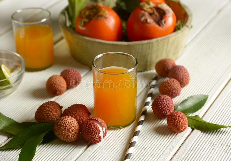 Delicious syrup made with persimmon juice and lychees royalty free stock image