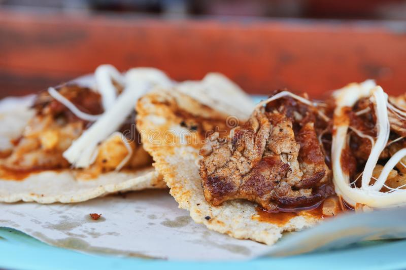 Delicious meat tacos with cheese and sauce royalty free stock images