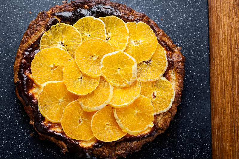 Delicious tart with cottage cheese and sliced orange royalty free stock image