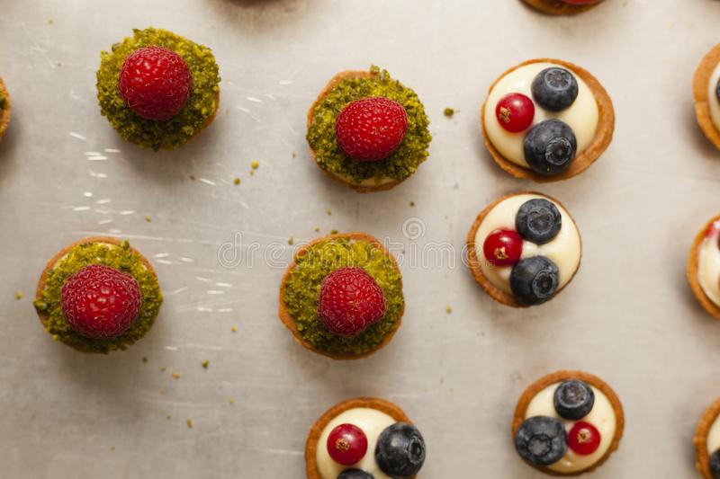 Delicious tartelets filled with fruits royalty free stock photography