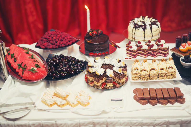 Delicious and tasty dessert table at wedding reception. Delicious and tasty dessert table on buffet table stock photos