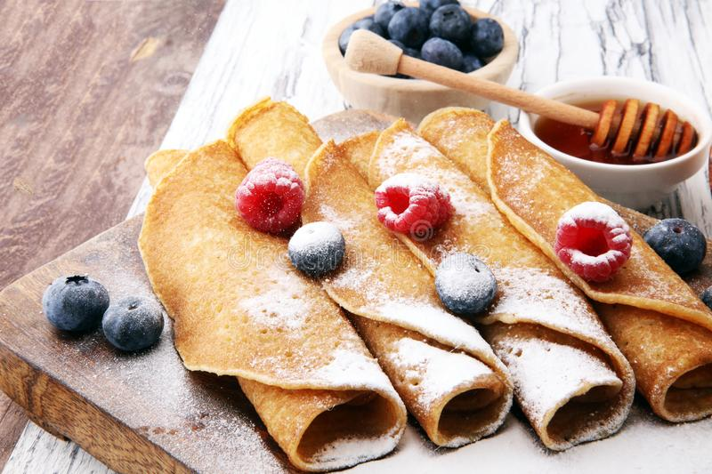 Delicious Tasty Homemade crepes or pancakes with raspberries and royalty free stock photography