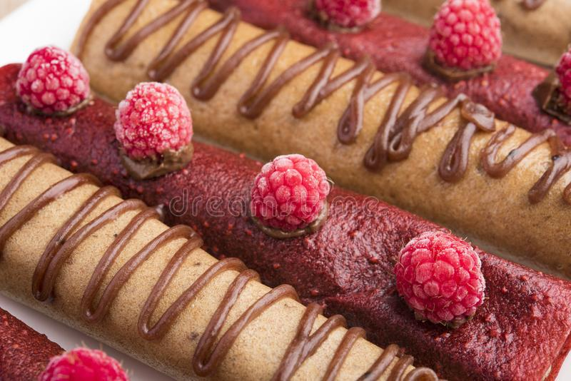 Delicious Tasty Homemade crepes or pancakes with raspberries and chocolate and cream filling royalty free stock images