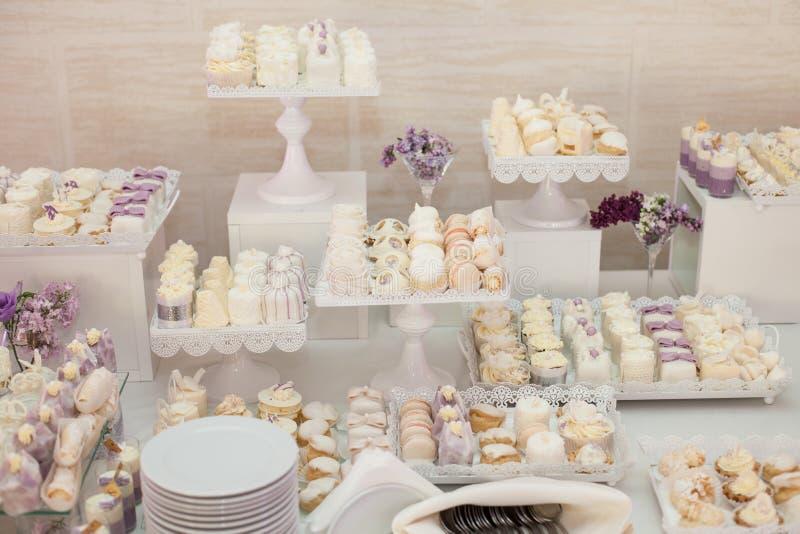 Delicious & tasty white decorated cupcakes at wedding reception. Closeup stock photos
