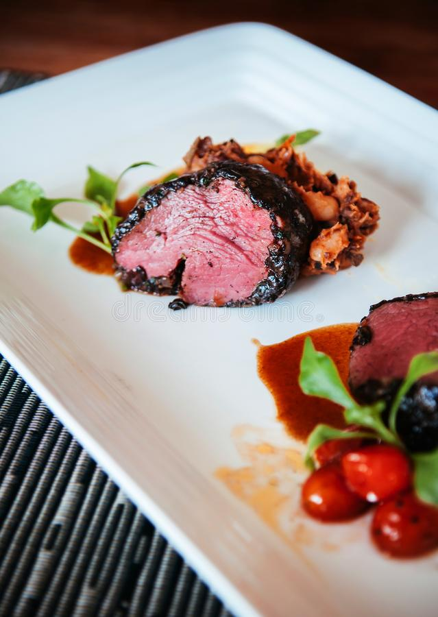Beef tenderloin steak with red wine gravy sauce and ratatouille stock photos