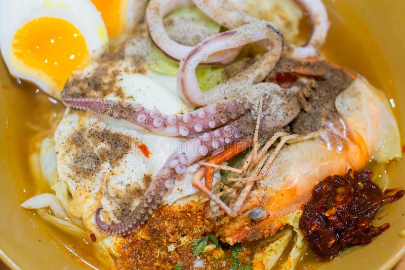Delicious Thai food. Noodle with hot and sour seafood prawn and squid soup with slice boiled egg and vegetable in brown bowl at. Cafe and restaurant stock photos